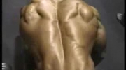 Bodybuilder David Henry rows, poses back